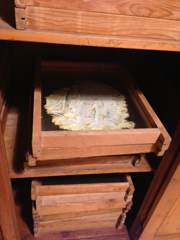 Flowers pressed on animal fat for scent absorption.